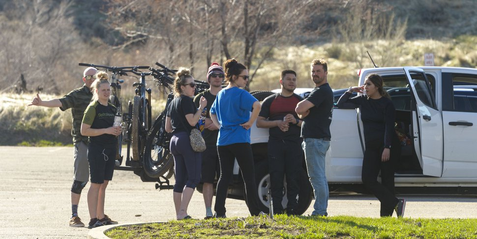 (Leah Hogsten | The Salt Lake Tribune) Families and friends congregate around their cars in the Rainbow Gardens gift shop and restaurant parking lot in Ogden on Sunday after hikes and bike rides in the foothills and the nearby Ogden River Trail, March 22, 2020. As the global battle against COVID-19 deepens, some Utahns have used the state's great outdoors as an alternative to isolating at home.