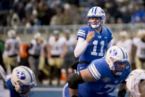 (Jeremy Harmon     Tribune file photo) Brigham Young Cougars quarterback Zach Wilson (11) helms his team as BYU faces the Western Michigan Broncos in the Famous Idaho Potato Bowl in Boise, Idaho, on Friday, Dec. 21, 2018.