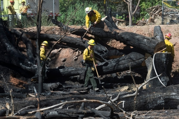 (Rick Egan | The Salt Lake Tribune) Firefighters from Utah Division of Forestry, Fire and State Lands work on hot spots from yesterdays fire in Moab. Wednesday, June 13, 2018.