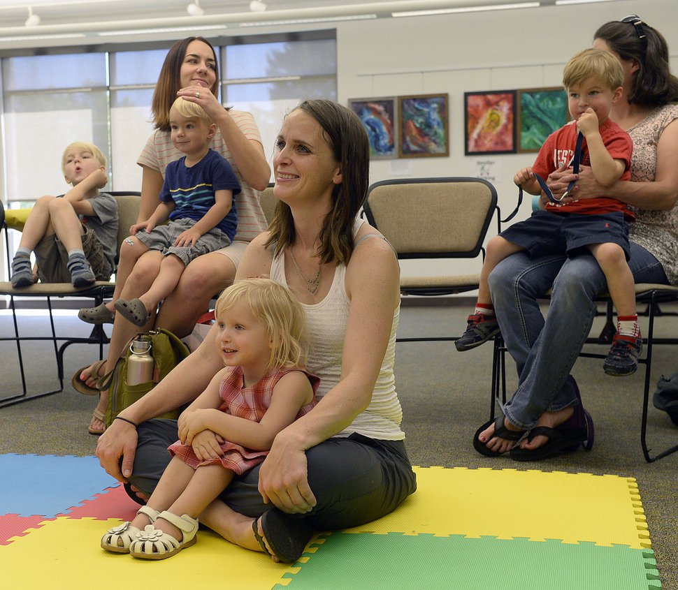Al Hartmann | The Salt Lake Tribune Heather May takes in story time for pre school children and their parents at the Holladay Library Thursday June 22 with her daughter Margot, almost three-years old. The first of several activities for a