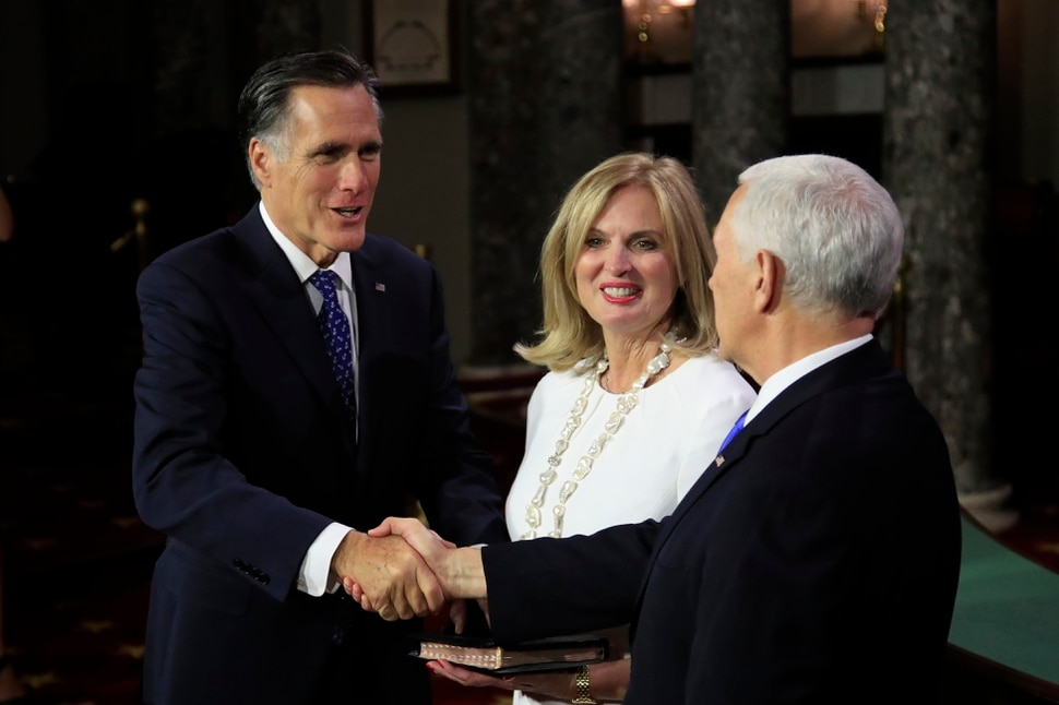Vice President Mike Pence shakes hands with Sen. Mitt Romney, R-Utah, accompanied by his wife Ann Romney, during a mock swearing-in ceremony Thursday, Jan. 3, 2019, in the Old Senate Chamber on Capitol Hill in Washington. (AP Photo/Manuel Balce Ceneta)
