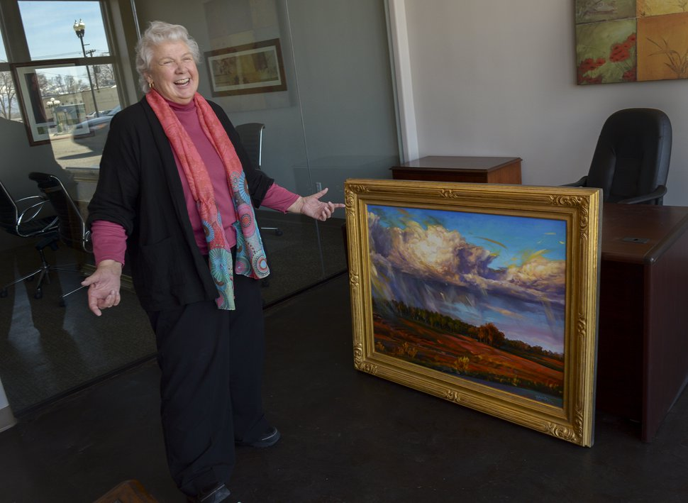 "(Leah Hogsten | The Salt Lake Tribune) Judith Mehr says she was stunned when police officers contacted her to tell her one of her two paintings that were stolen in December had been recovered. Here she is reunited with her ""Thundercloud Upheaval at Dove Creek."""
