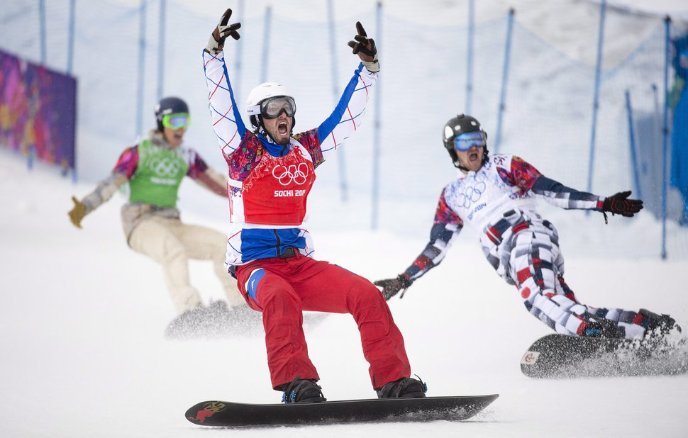 (AP File Photo/The Canadian Press, Jonathan Hayward) Bronze medalist Alex Deibold, left, gold medalist Pierre Vaultier of France, center, and silver medalist Nikolay Olyunin, of Russia, celebrate their win as they cross the finish line during the men's Snowboardcross final at the Sochi Winter Olympics in Krasnaya Polyana, Russia, on Tuesday, Feb. 18, 2014. Deibold is one of a growing number of winter-sports athletes speaking out on climate change.