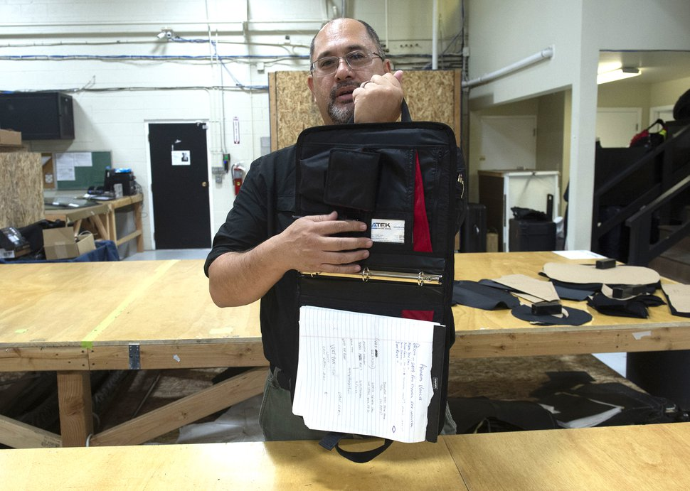 (Rick Egan | The Salt Lake Tribune) Aaron Gilbert demonstrates a 3-ring binder that doubles as a shield. Gilbert runs Citizen Armor, a company in Provo that makes bulletproof backpacks and other products, such asa bullet proof binder at his company headquarters in Provo, Monday, Aug. 5, 2019.