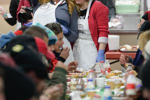 Francisco Kjolseth | The Salt Lake TribuneJulie Edwards, left, flags down an available seat as she is joined by Claudia Pohl, as volunteers and community leaders served their annual Christmas dinner to more than 800 homeless Utahns Friday at St. Vincent de Paul Dining Hall in downtown Salt Lake City.