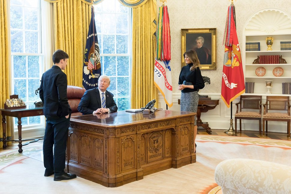 (Andrea Wise | Official White House Photo | The Washington Post) President Trump and Melania Trump meet with Kyle Kashuv in the Oval Office.