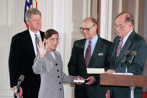 (Marcy Nighswander | AP file photo)  In this Aug. 10, 1993, photo, Supreme Court Justice Ruth Bader Ginsburg takes the court oath from Chief Justice William Rehnquist, right, during a ceremony in the East Room of the White House in Washington. Ginsburg's husband Martin holds the Bible and President Bill Clinton watches at left. The Supreme Court says Ginsburg has died of metastatic pancreatic cancer at age 87.
