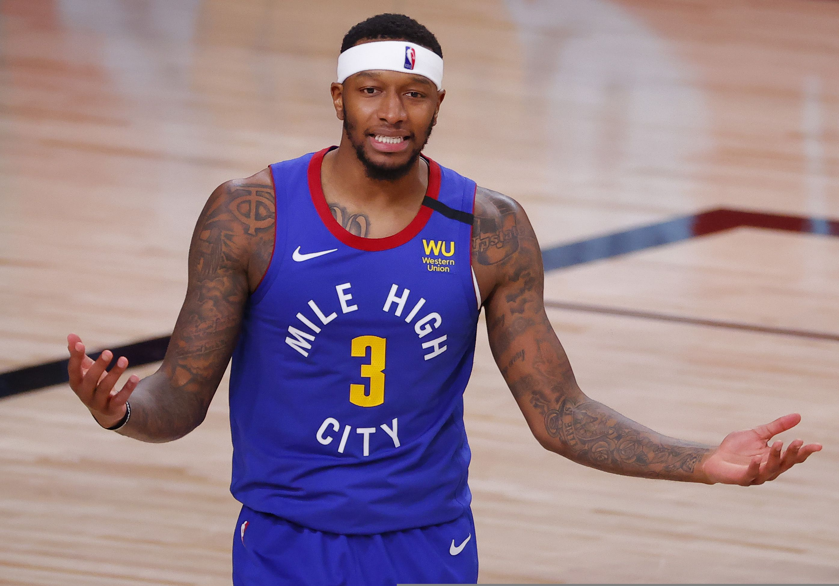 Denver Nuggets' Torrey Craig reacts during the third quarter against the Utah Jazz in Game 4 of an NBA basketball first-round playoff series, Sunday, Aug. 23, 2020, in Lake Buena Vista, Fla. (Kevin C. Cox/Pool Photo via AP)