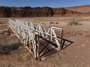 (Francisco Kjolseth  | The Salt Lake Tribune) A walking pier sits idle at Hite Marina hundreds of yards from the edge of the Colorado River as it flows into Lake Powell on Thursday, Feb. 4, 2021.
