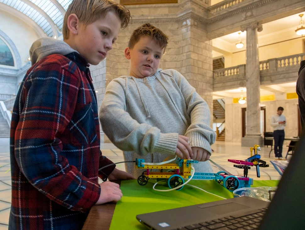 (Rick Egan | The Salt Lake Tribune) Aaron Stettler and Josh Reading, 5th graders from Horizon Elementary School, present their science project at the Capitol, Monday, Dec. 9, 2019. Gov. Gary Herbert proclaimed the second week in December as Computer Science Education Week in Utah and announced new computer science funding for Utah students.