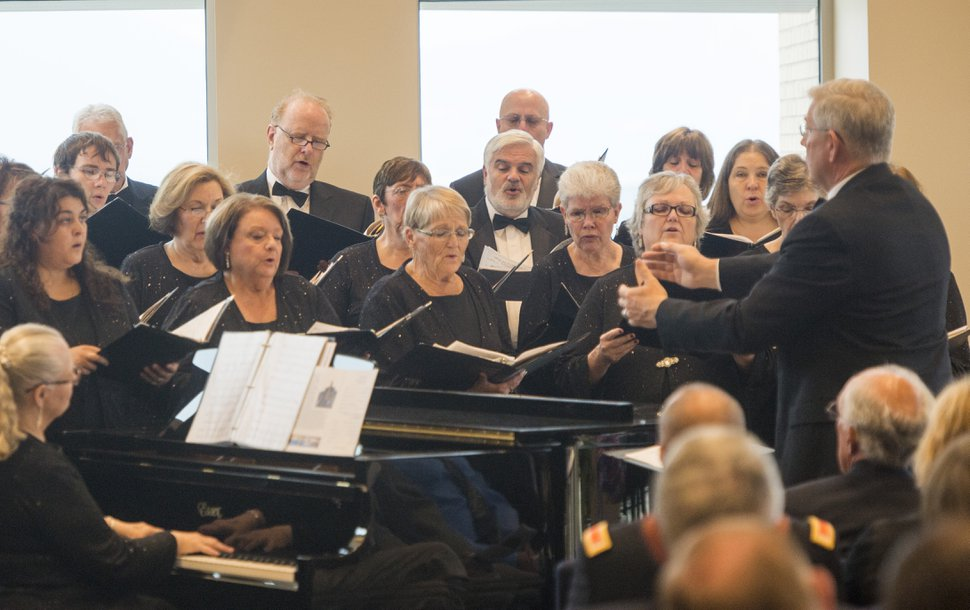 Rick Egan | The Salt Lake Tribune The Choral Arts Society of Utah sings a musical number at the ribbon-cutting ceremony for Sunrise Hall, a newly constructed worship center at Camp Williams. Friday, August 7, 2015.