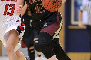 (Trent Nelson  |  The Salt Lake Tribune)  Viewmont's Mercedes Staples drives past Sara Noel as Woods Cross hosts Viewmont High School girls basketball, Wednesday, January 24, 2018.