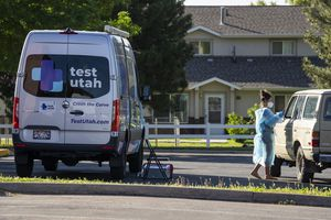 (Rick Egan | The Salt Lake Tribune)  A nurse from test Utah tests for Covid-19 in the parking lot of the South East Health Department, in Moab, on Friday, May 14, 2021.