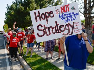 (Francisco Kjolseth     The Salt Lake Tribune) Jennifer Levy who teaches arts at two different schools and sees 1200 students, joins hundreds of Granite School district teachers gathered at the Granite School District office on Tuesday, August 4, 2020, to protest the district's plans for reopening, which will allow students back into the classroom, like normal, five days a week.