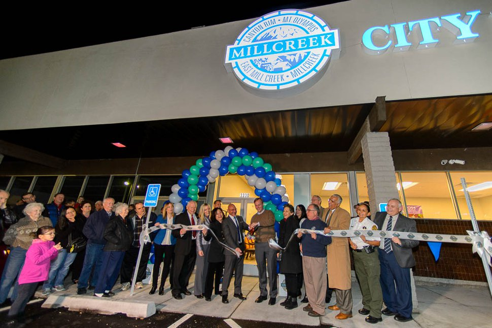 (Trent Nelson | The Salt Lake Tribune) Dignitaries cut the ribbon as the City of Millcreek celebrates its first birthday and grand opening of its City Hall, Wednesday, Jan. 10, 2018.
