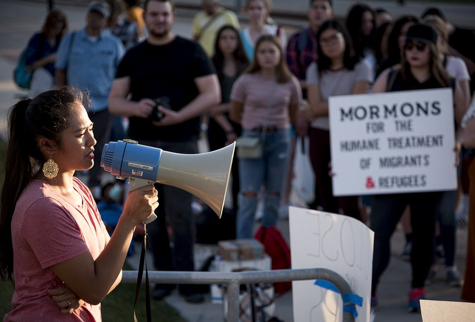 (Michael Mangum | Special to The Tribune) Claudia Loayza of South Jordan speaks to the crowd during a protest outside the U.S. Immigration and Customs Enforcement Field Office in West Valley City on Wednesday, July 24, 2019.