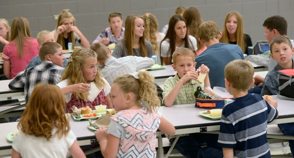 (Al Hartmann | Tribune file photo) Students and staff at lunch at Park Valley School, a small rural school in Box Elder School District. Such districts are often at a funding disadvantage compared to schools In Utah with more valuable property tax bases.