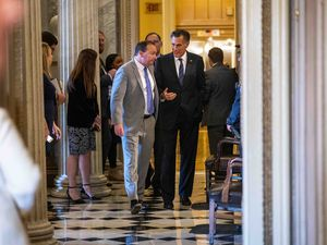 (Doug Mills | New York Times file photo) Sens. Mitt Romney,  R-Utah, right, and Mike Lee, R-Utah, chat prior to the first Senate impeachment trial of President Donald Trump, Jan. 30, 2020. Romney and Lee took very different approaches to their questions in the second trial on Friday.