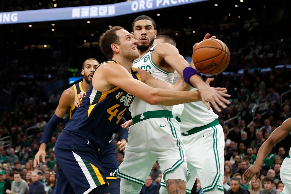 Boston Celtics' Jayson Tatum, front right, fouls Utah Jazz's Bojan Bogdanovic while knocking the ball away during the first quarter of an NBA basketball game Friday, March 6, 2020, in Boston. (AP Photo/Winslow Townson)