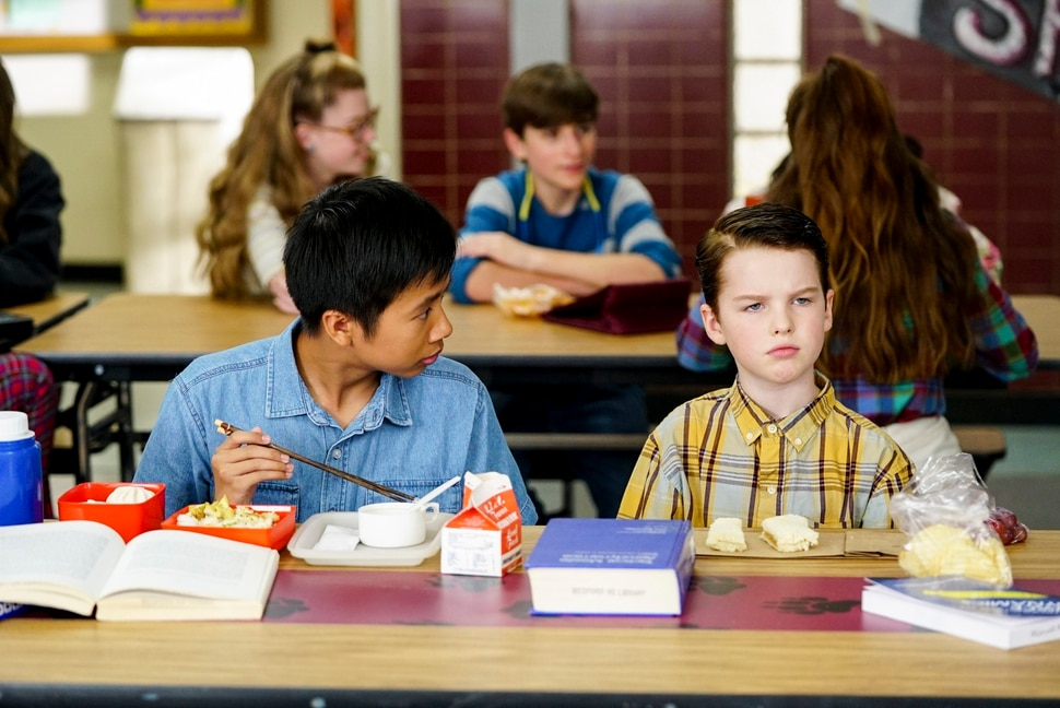 "(Photo: Robert Voets/Warner Bros.) Tam (Ryan Phuong) and Sheldon (Iain Armitage) work on a model rocket on ""Young Sheldon."""