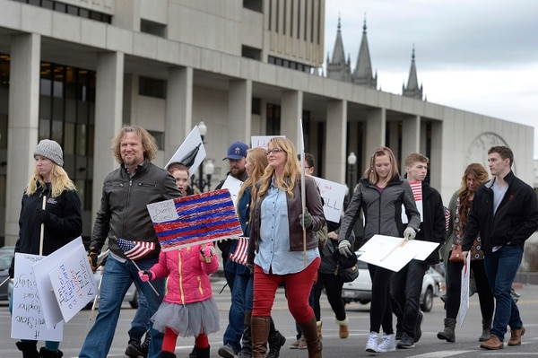 Scott Sommerdorf | The Salt Lake Tribune Polygamist Kody Brown and his family marched across State Street near the LDS Office Building in order to meet up with other polygamists and supporters before marching to the Capitol, where they held a rally, Friday, Feb. 10, 2017.