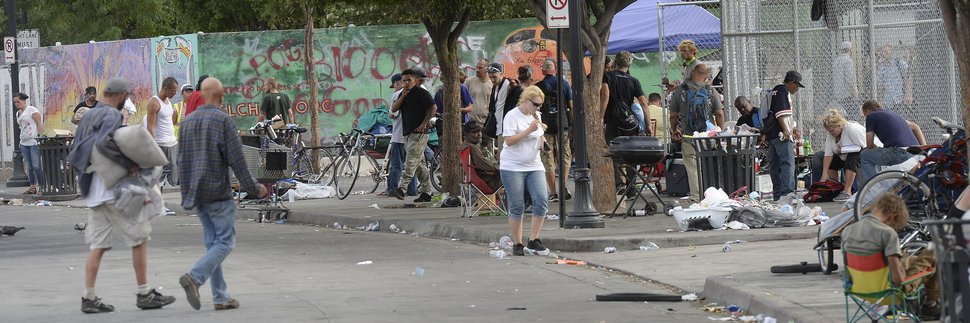Al Hartmann | The Salt Lake Tribune Scene along 500 West between 200 and 300 S. Wednesday July 19. Many homeless people sleep on sidewalk with their belongings and makeshift shelters. Camping on the street is a class B misdemeanor and can now be enforced.