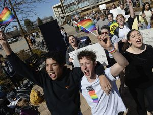 """Lorenzo Larios, left, and Danny Niemann chant """"gay rights"""" as they join the student protest outside the student center at Brigham Young University in Provo, Utah Wednesday, March 4, 2020, after an official with the Church of Jesus Christ of Latter-day Saints school issued a clarification to the school's Honor Code, which said that same-sex romantic behavior is still """"not compatible"""" with the rules at BYU. (Francisco Kjolseth/The Salt Lake Tribune via AP)"""