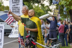 (Leah Hogsten   The Salt Lake Tribune) Protesters waving American flags and holding signs decrying mask and vaccine mandates gathered along the curb of 700 East in Liberty Park Saturday, making Salt Lake City one of dozens of cities around the world protesting public health-related restrictions, Sept. 18, 2021.