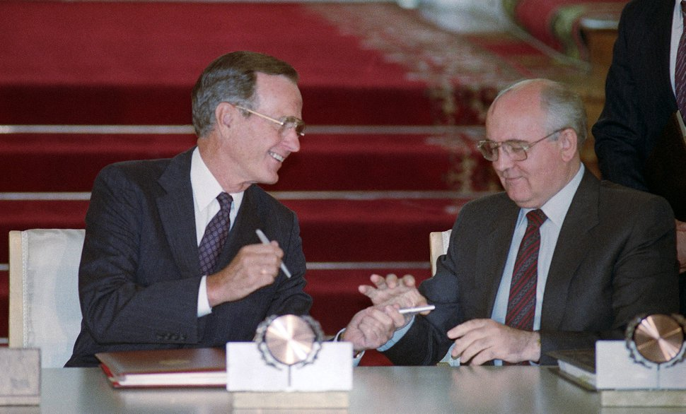 FILE - In this file photo taken Wednesday, Aug. 1, 1991, U.S. President George H. Bush and Soviet President Mikhail Gorbachev exchange pens after signing the START arms reduction treaty in the Kremlin, Moscow. Former Soviet premier Mikhail Gorbachev expressed his