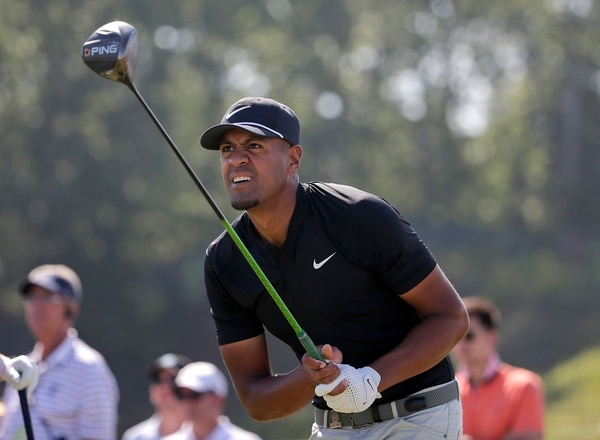Tony Finau plays his shot from the ninth tee during the final round of the U.S. Open Golf Championship, Sunday, June 17, 2018, in Southampton, N.Y. (AP Photo/Seth Wenig)