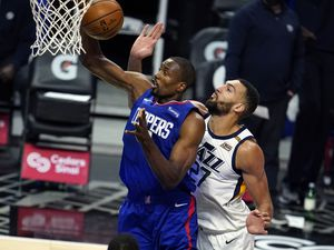 Los Angeles Clippers forward Serge Ibaka, left, grabs a rebound next to Utah Jazz center Rudy Gobert during the first half of an NBA basketball game Wednesday, Feb. 17, 2021, in Los Angeles. (AP Photo/Marcio Jose Sanchez)