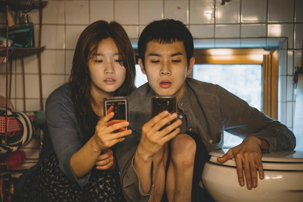 This image released by Neon shows So-dam Park, left, and Woo-sik Choi in a scene from Parasite. (Neon via AP)