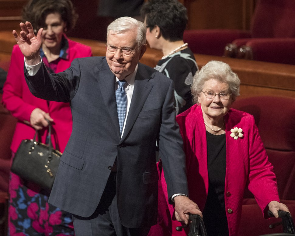 (Rick Egan | The Salt Lake Tribune) Elder M. Russell Ballard waves as he leaves the stand with his wife, Barbara Ballard, after the Saturday morning session of the188th Annual General Conference in Salt Lake City, Saturday, March 31, 2018.