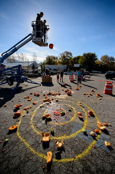(Trent Nelson | The Salt Lake Tribune) A pumpkin is smashed at Glover Nursery in West Jordan on Saturday Nov. 3, 2018. The nursery held its annual pumpkin smash and food drive, dropping pumpkins from a cherry picker and collecting donations for the needy.