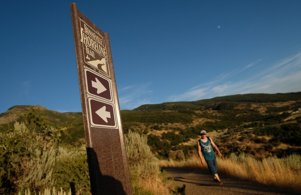 (Francisco Kjolseth | The Salt Lake Tribune) People take to the Adams Canyon trailhead in Layton on Friday evening, Aug. 9, 2019, as it connects to the Bonneville Shoreline Trail. Davis County is proposing to tie its many fragments of the famous Bonneville Shoreline Trail into an unbroken stretch from City Creek Canyon to the Weber River.
