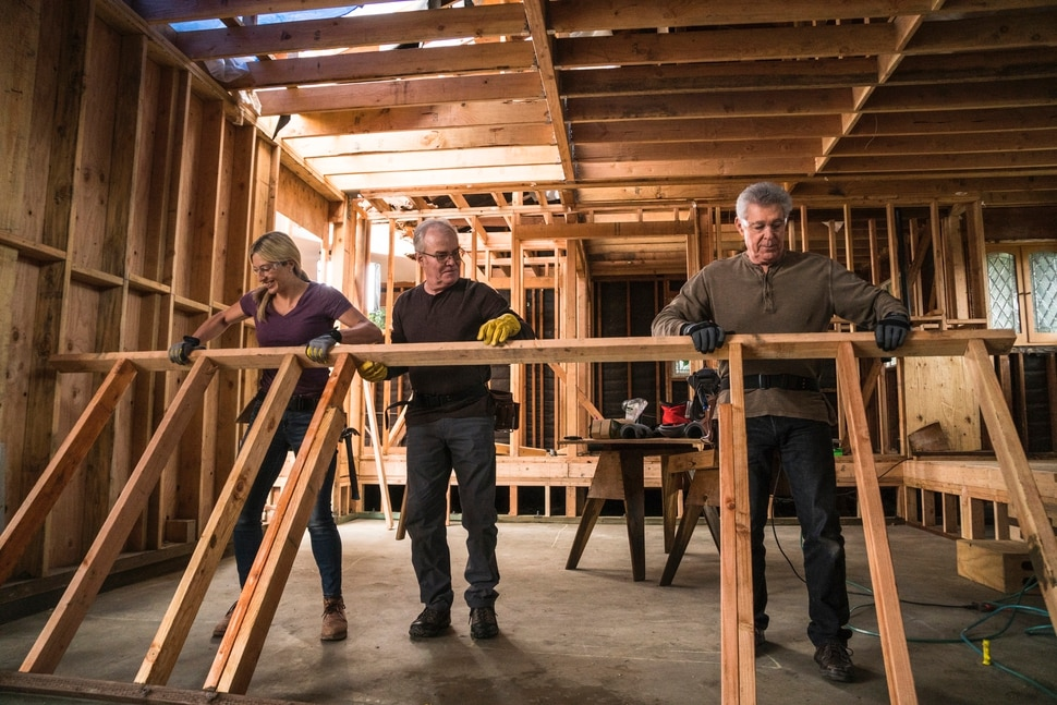 """(Photo courtesy Menesa Pritchett/HGTV) Jasmine Roth, Mike Lookinland and Barry Williams work on the house in """"A Very Brady Renovation."""""""