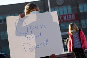 (Francisco Kjolseth | The Salt Lake Tribune) Gabriel Hansen, 12, joins the protest at East High in Salt Lake City on Monday, Dec. 7, 2020, in response to more students failing this fall with classes entirely online due to the coronavirus pandemic. Salt Lake City's school board decided Tuesday, Jan. 20, 2021, to allow junior high and high school students to return for in-person learning, in part, because of that.