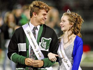 (John Zsiray   5150photos.com via AP) Deserae Turner stands with Case Gehring as the Homecoming Court is announced during halftime of Green Canyon's football game in North Logan, Sept. 27, 2019.