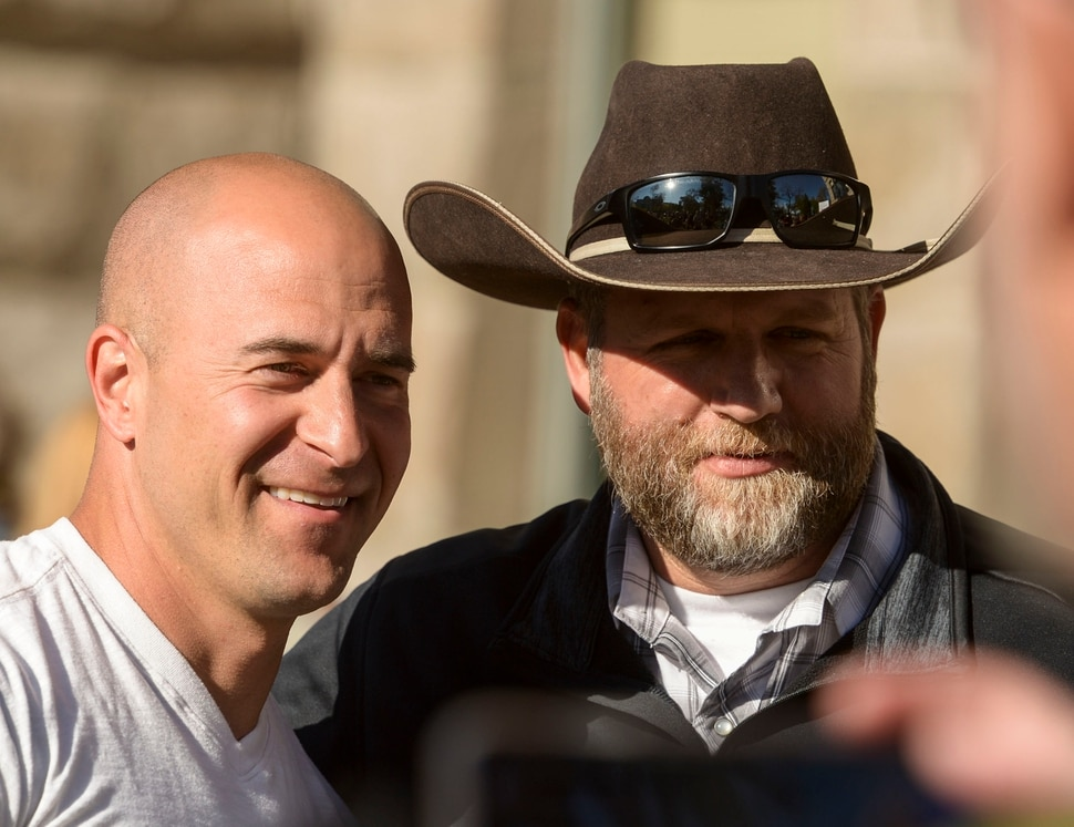 (Leah Hogsten | The Salt Lake Tribune) l-r Eric Moutsos, event organizer and Ammon Bundy pose for a photo. About 1,000 people protested the government mandated shutdown of businesses on the grounds of Salt Lake City Hall, Saturday. The protest was organized by Utah Business Revival aimed at Mayor Erin Mendenhall, Salt Lake County Mayor Jenny Wilsonand Governor Gary Herbert policies on COVID-19 and social distancing, April 18, 2020.