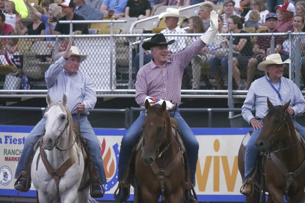Interior Secretary Ryan Zinke, center, rides around the arena and waves to the crowd after speaking at the Days of '47 Rodeo, on the Utah holiday Pioneer Day, Tuesday, July 24, 2018, in Salt lake City. (AP Photo/Rick Bowmer)