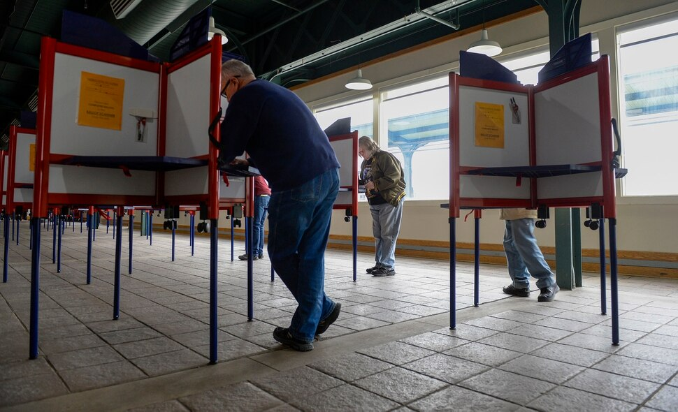 (Leah Hogsten | The Salt Lake Tribune) Voters cast their ballots at Ogden's Union Station during Utah's Super Tuesday primary, Mar. 3, 2020,