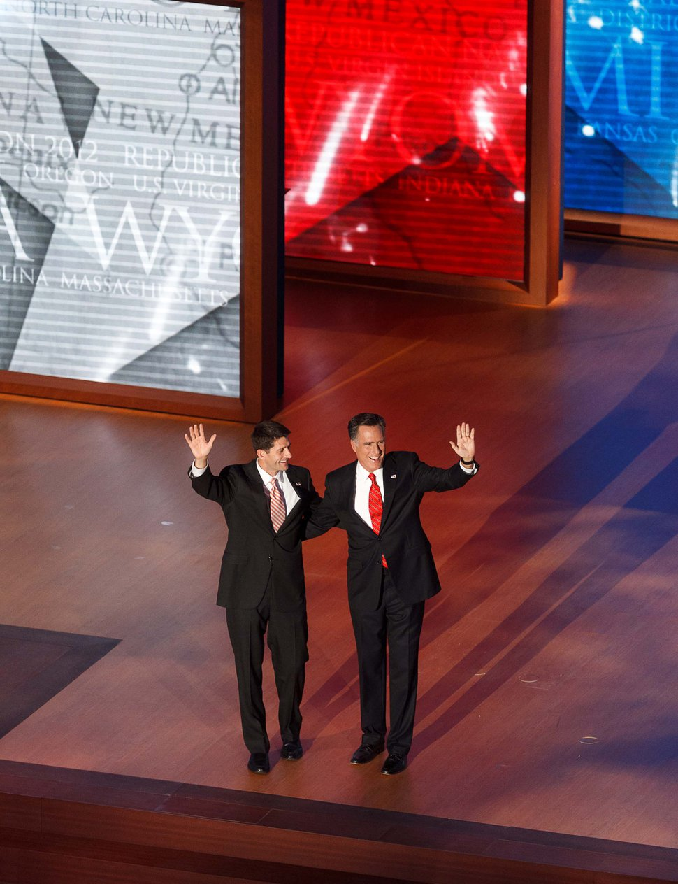 (Trent Nelson | Tribune file photo) Mitt Romney and running mate Paul Ryan wave at the close of the Republican National Convention in Tampa, Florida on August 30, 2012.
