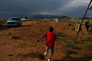 (Chris Detrick  |  The Salt Lake Tribune) Danny Gonzalez, 6, plays outside of his home in Westwater on Thursday, August 19, 2010. The Navajo residents of Westwater live without running water, plumbing, sewage disposal or electricity.