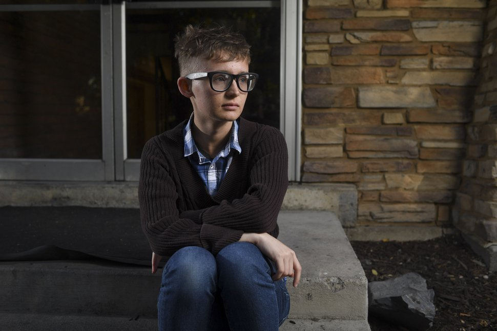 (Isaac Hale/The Daily Herald via AP) In this Oct. 18, 2017, photo, Andy Winder, then a senior at Brigham Young University, who is also transgender, poses for a portrait in Provo.