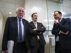 (AP file photo) From left, Sen. Bernie Sanders, I-Vt., Sen. Chris Murphy, D-Conn., and Sen. Mike Lee, R-Utah, meet before holding a news conference on Wednesday, March 13, 2019. The three are teaming up on a bill to limit the president's war powers.