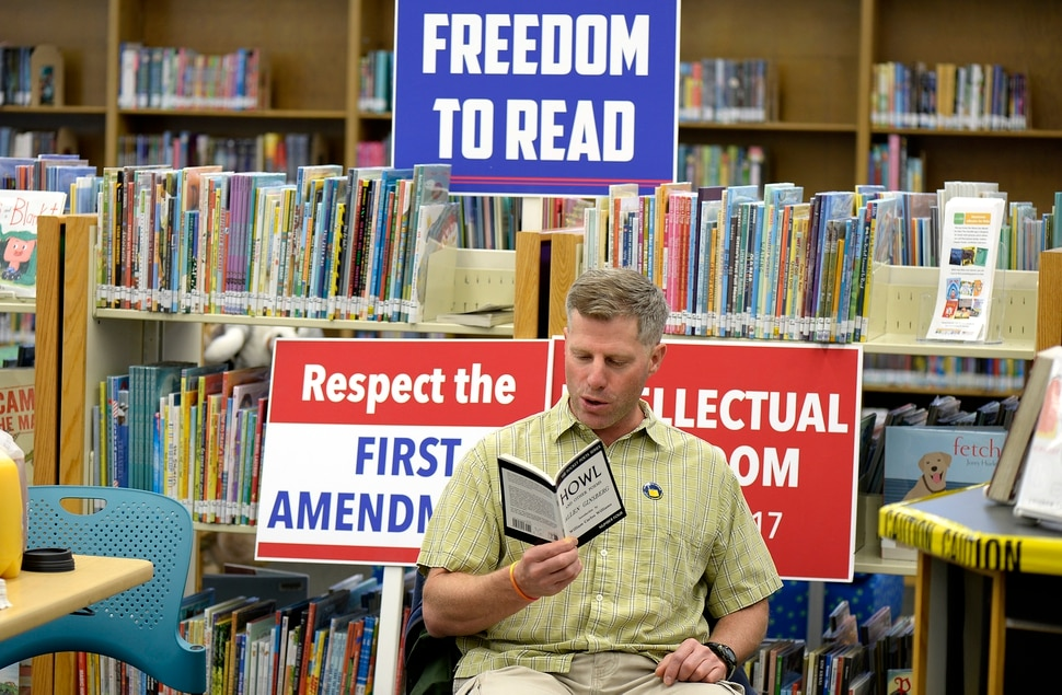 (Scott Sommerdorf | The Salt Lake Tribune) Carvel Harward reads a copy of Allen Ginsberg's Howl at the Smith Branch of the County Library. The public was invited to bring their favorite banned book to the Smith branch and participate in a Facebook live event where they would all read from their banned books, simultaneously, for approximately three minutes in celebration of our intellectual freedom, Sunday, September 24, 2017.