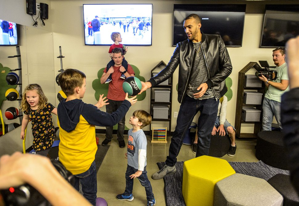 (Steve Griffin | The Salt Lake Tribune) Utah Jazz center Rudy Gobert joins children and their families in the new Sensory Room designed and built by Vivint Smart Home and the Utah Jazz inside the arena in Salt Lake City Wednesday March 14, 2018. The sensory room for individuals with intellectual and developmental disabilities opens to the public March 30.