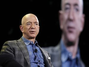 (John Locher | AP file photo)  Amazon CEO Jeff Bezos speaks at the the Amazon re:MARS convention in Las Vegas on June 6, 2019.