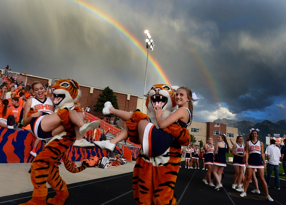 (Scott Sommerdorf | The Salt Lake Tribune) Brighton mascots playfully ran off with cheerleaders as Brighton hosted rival Bingham in a 5A game played Friday, September 26, 2014.