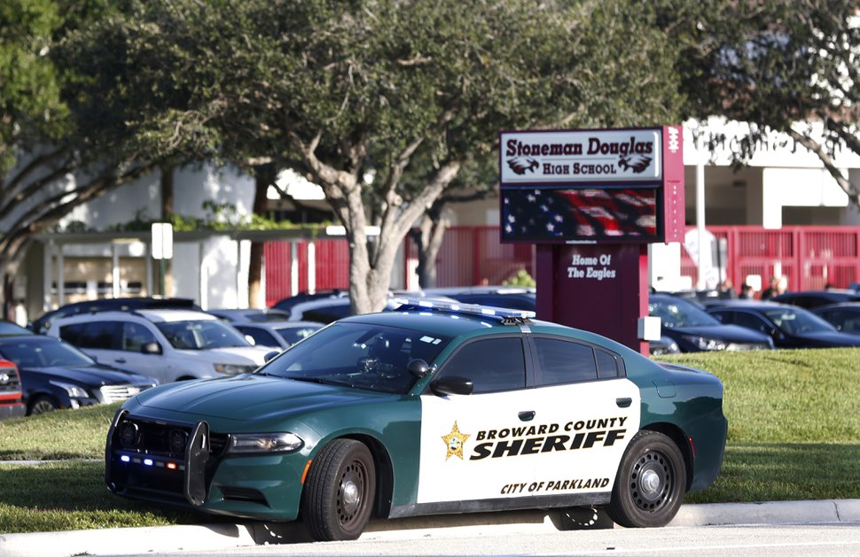 (Wilfredo Lee | AP file photo) In this Aug. 15, 2018, file photo, a Broward County Sheriff's Office vehicle is parked outside Marjory Stoneman Douglas High School, in Parkland, Fla.